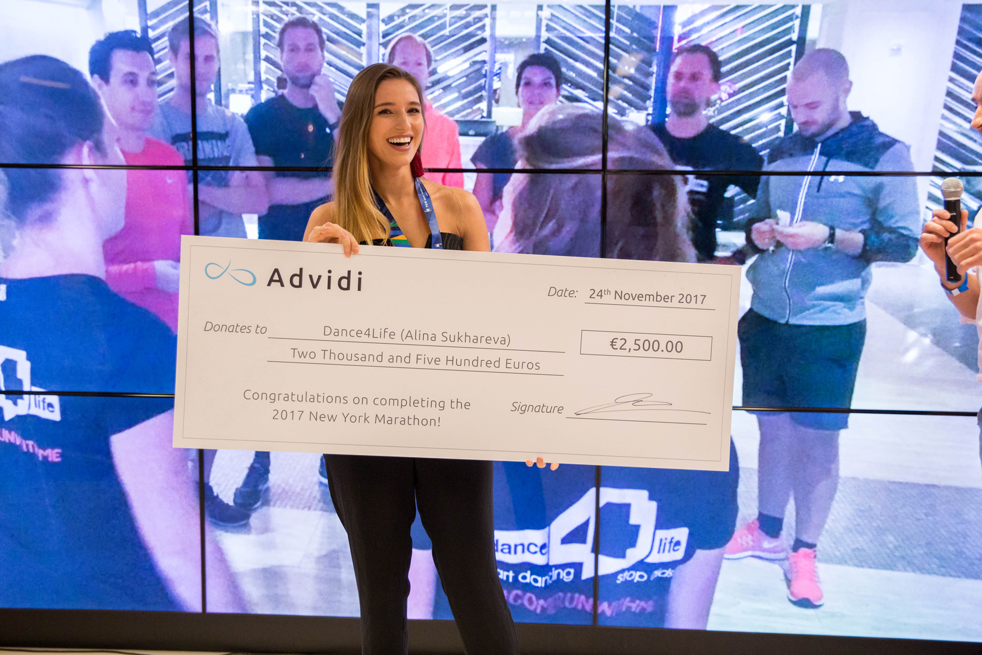 Alina collects the donation from Advidi