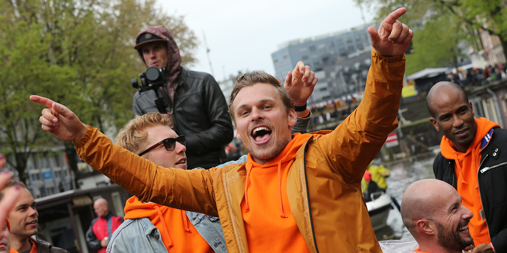 King's Day - People partying dressed in orange